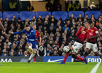 Football - 2018 / 2019 Emirates FA Cup - Fifth Round: Chelsea vs. Manchester United <br /> <br /> Eden Hazard (Chelsea FC)  attempts to bend the ball around Chris Smalling (Manchester United) at Stamford Bridge<br /> <br /> COLORSPORT/DANIEL BEARHAM