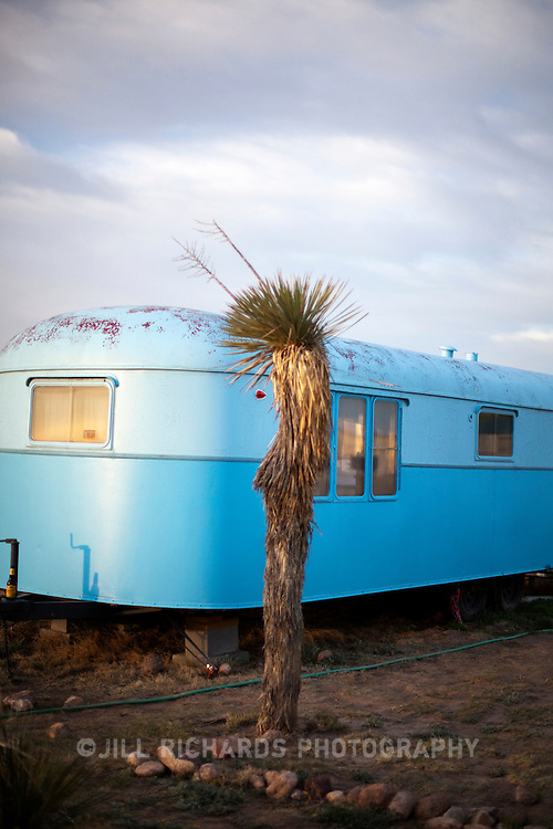 El Cosmico, created by Austin's Liz Lambert,  located in Marfa, Texas offers unique accommodations to travelers with its restored vintage trailers, bamboo-floored yurts and 22-ft diameter teepee. The communal bathhouse and kitchen make staying at El Cosmico an adventure.