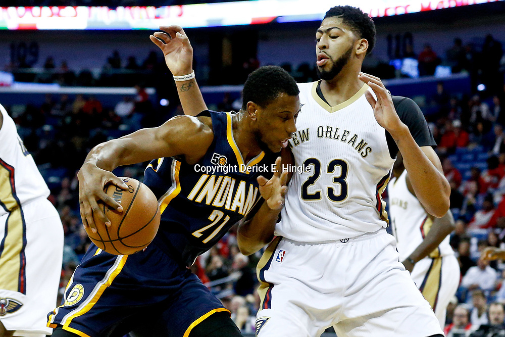 Dec 15, 2016; New Orleans, LA, USA; Indiana Pacers forward Thaddeus Young (21) drives in against New Orleans Pelicans forward Anthony Davis (23) during the first quarter of a game at the Smoothie King Center. Mandatory Credit: Derick E. Hingle-USA TODAY Sports