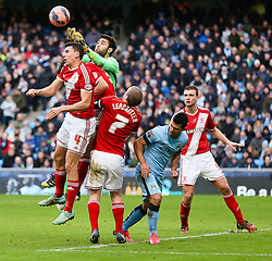 Middlesbrough's Tomas Mejias punches the ball amongst a crowd of players - Photo mandatory by-line: Matt McNulty/JMP - Mobile: 07966 386802 - 24/01/2015 - SPORT - Football - Manchester - Etihad Stadium - Manchester City v Middlesbrough - FA Cup Fourth Round