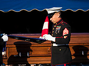 22 NOVEMBER 2019 - DES MOINES, IOWA: Members of the US Marine Corps Honor Guard fold the US flag at the reinterment service of US Marine Corps Reserve Private Channing Whitaker. The flag was presented to surviving family members. Whitaker died in the Battle of Tarawa on Nov. 22, 1943. He was buried on Betio Island, in the Gilbert Islands, and his remains were recovered in March 2019. He was identified by a DNA match with surviving family members in Iowa. Whitaker was reintered in the Glendale Cemetery in Des Moines exactly 76 years after his death in World War Two. About 1,000 US Marines and sailers were killed in four days during the Battle of Tarawa.            PHOTO BY JACK KURTZ