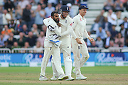 Adil Rashid of England is hugged by Jonny Bairstow of England after getting Virat Kohli of India out for 97 during the 3rd International Test Match 2018 match between England and India at Trent Bridge, West Bridgford, United Kingdon on 18 August 2018.