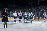 KELOWNA, CANADA - NOVEMBER 11: Photographer Cindy Rogers stands on the ice during the national anthem at the Kelowna Rockets against the Red Deer Rebels on November 11, 2017 at Prospera Place in Kelowna, British Columbia, Canada.  (Photo by Marissa Baecker/Shoot the Breeze)  *** Local Caption ***