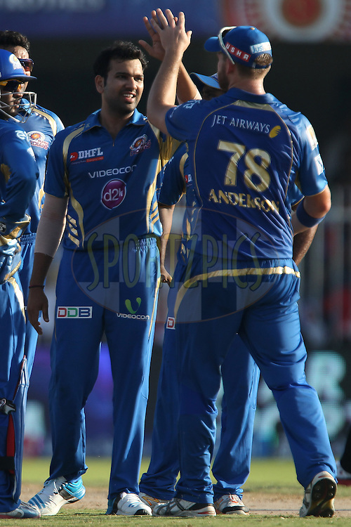 Rohit Sharma captain of of the Mumbai Indians celebrates the wicket of Murali Vijay of the Delhi Daredevils during match 16 of the Pepsi Indian Premier League 2014 between the Delhi Daredevils and the Mumbai Indians held at the Sharjah Cricket Stadium, Sharjah, United Arab Emirates on the 27th April 2014<br /> <br /> Photo by Ron Gaunt / IPL / SPORTZPICS