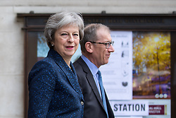 © Licensed to London News Pictures. 03/05/2018. London, UK. British Prime Minister Theresa May (left) and husband Philip May leave Methodist Central Hall this morning after placing their votes in the local elections. Photo credit : Tom Nicholson/LNP