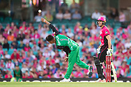 Melbourne Stars player Sandeep Lamichhane bowls the ball at the Big Bash League cricket match between Sydney Sixers and Melbourne Stars at The Sydney Cricket Ground in Sydney, Australia