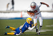 Manti wide running back Zane Stevens (8) drags along San Juan's Bobby Bowring (10) during the Utah High School 2A Football championship game between San Juan and Manti, Saturday, Nov. 10, 2012.
