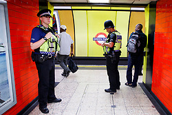 © Licensed to London News Pictures. 04/06/2017. London, UK. Police officers patrol at Green Park tube station in London following a terror attack that killed 6 people on London Bridge and Borough in central London. Photo credit: Tolga Akmen/LNP