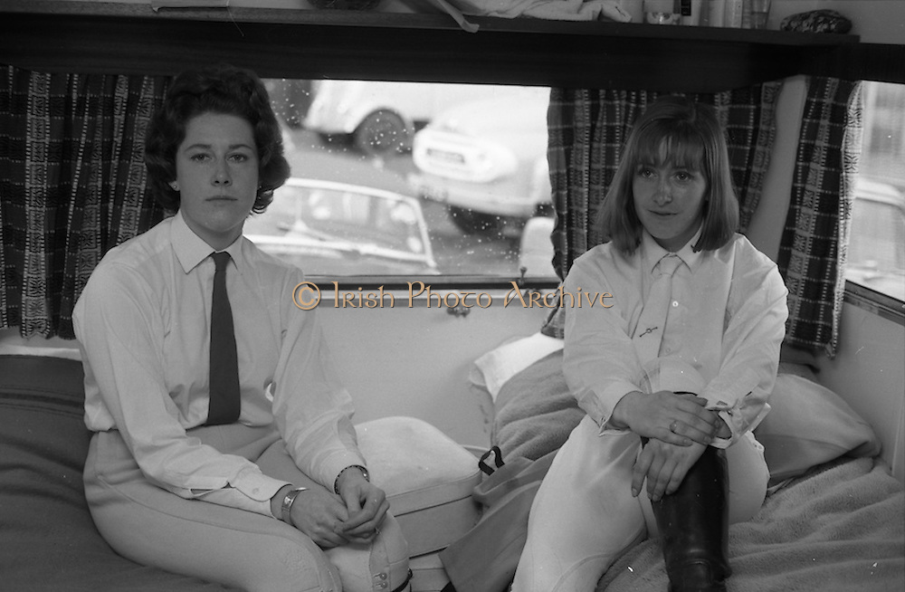 04/05/1965<br /> 05/04/1965<br /> 04 May 1965<br /> Pictures from the RDS Spring show for the Belfast Telegraph. Miss Patricia McKee (left) and Miss Heather Moore relaxing in their caravan during an interval between jumping competitions at the show.