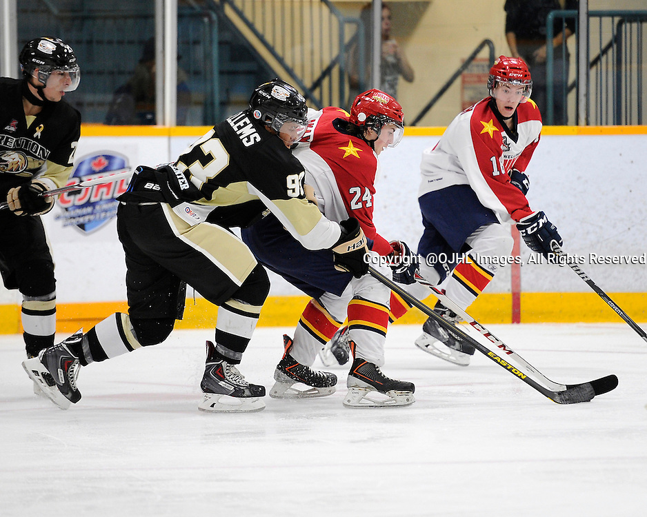 TRENTON, ON - Oct 3, 2014 : Ontario Junior Hockey League game action between Wellington and Trenton, Braden Hellems #93 of the Trenton Golden Hawks tries to get the puck from Ben Sokay #24 of the Wellington Dukes during the second period<br /> (Photo by Amy Deroche/ OJHL Images)
