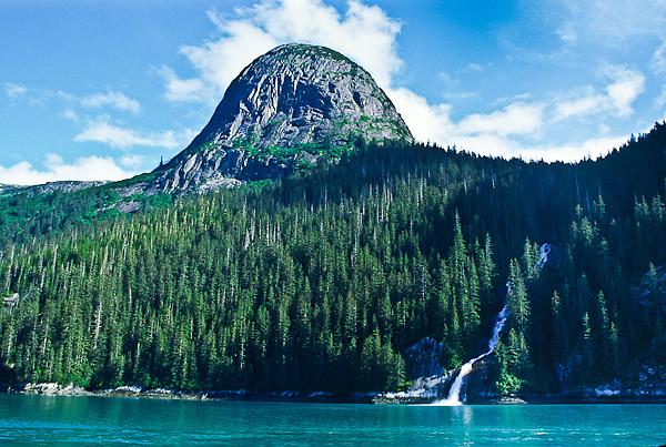 A glacial fed stream from the Coast Mountains cascades into Tracy Arm, Alaska.