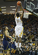 February 19 2011: Iowa Hawkeyes forward Melsahn Basabe (1) dunks the ball during the first half of an NCAA college basketball game at Carver-Hawkeye Arena in Iowa City, Iowa on February 19, 2011. Michigan defeated Iowa 75-72 in overtime.