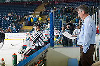 KELOWNA, CANADA - JANUARY 7: Claude Noel, head coach of the Vancouver Giants stands on the bench during warm up against the Kelowna Rocketson January 7, 2015 at Prospera Place in Kelowna, British Columbia, Canada.  (Photo by Marissa Baecker/Shoot the Breeze)  *** Local Caption *** Claude Noel;