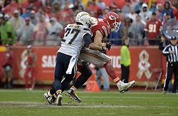 Dec 13, 2015; Kansas City, MO, USA; Kansas City Chiefs tight end Travis Kelce (87) catches a pass and is tackled by San Diego Chargers strong safety Jimmy Wilson (27) during the second half at Arrowhead Stadium. Kansas City won 10-3. Mandatory Credit: Denny Medley-USA TODAY Sports