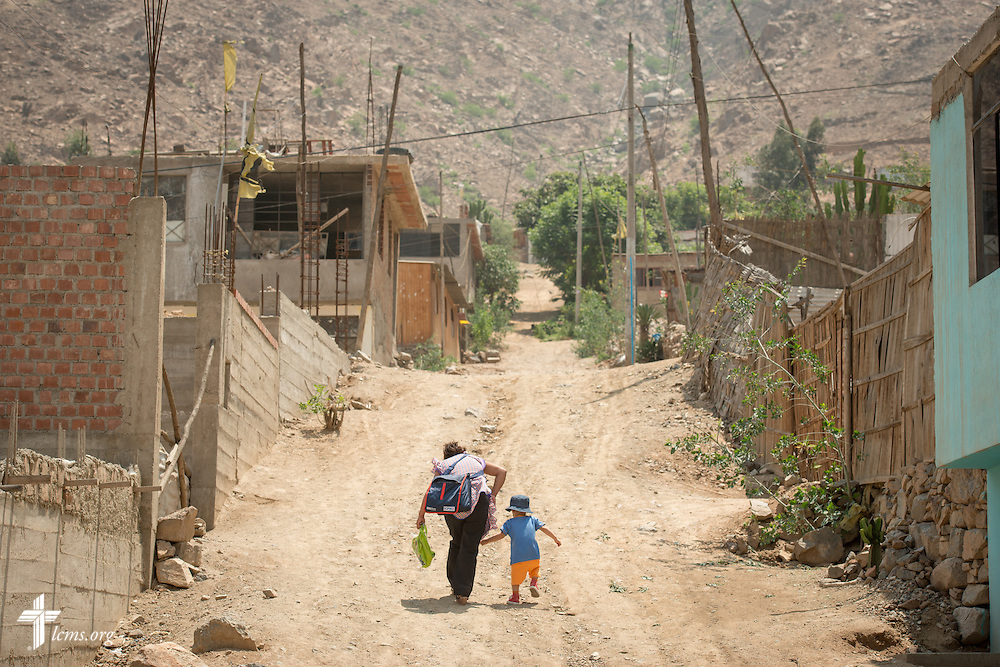 Residents head home in the landslide affected area of Huayaringa, Peru, on Tuesday, April 7, 2015.  LCMS Communications/Erik M. Lunsford