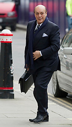 © Licensed to London News Pictures. 23/01/2012. London, UK. .Cypriot businessman Asil Nadir arriving at the Old Bailey where he faces charges over an alleged £34m fraud at his firm Polly Peck. Nadir, who fled to Cyprus in 1993 after the charges were first brought by the SFO, was ordered to return to the UK at a High Court hearing. Photo credit: Simon Jacobs/LNP