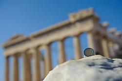THEMENBILD - Finanzkrise in Griechenland. Bild zeigt eine Zwei Euro Muenze, im Hintergrund die Akropolis. EXPA Pictures © 2011, PhotoCredit: EXPA/ S. Zangrando