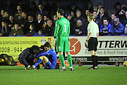 AFC Wimbledon defender George Francomb (7) down injured during the EFL Sky Bet League 1 match between AFC Wimbledon and Coventry City at the Cherry Red Records Stadium, Kingston, England on 14 February 2017. Photo by Matthew Redman.