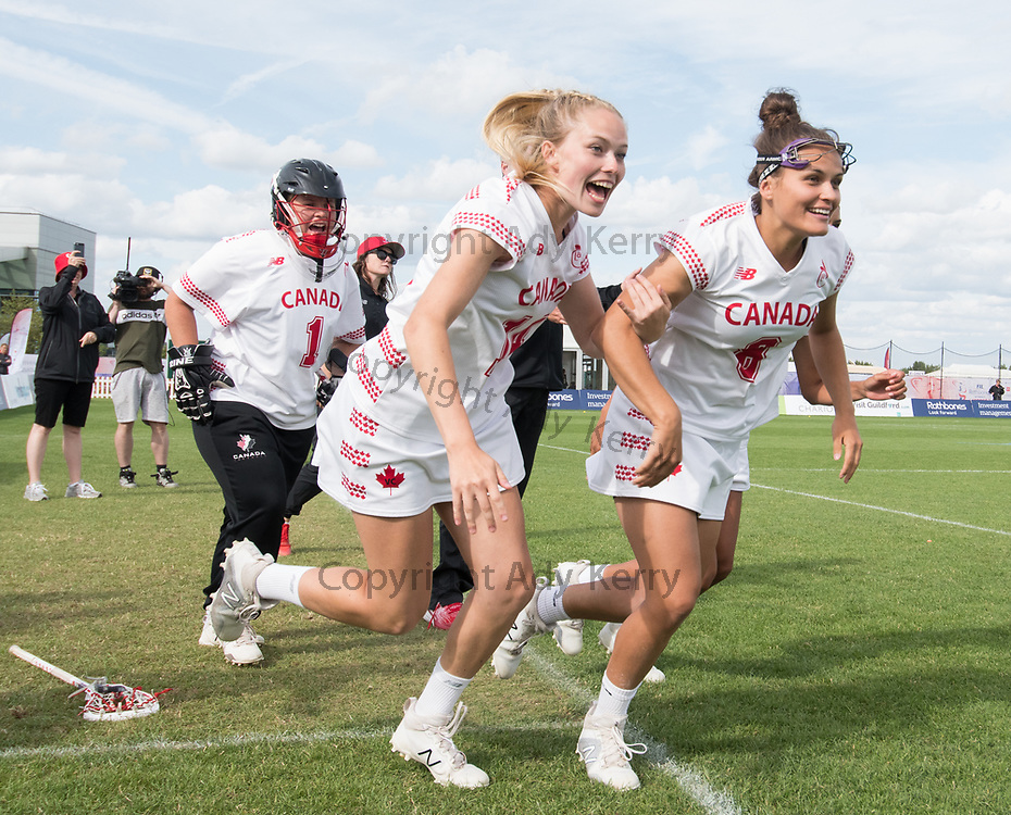 L-R; Allison Daley, Claire Mills, Danita Stroup run on to celebrate with their team at the end of the semi final win against Australia at the 2017 FIL Rathbones Women's Lacrosse World Cup at Surrey Sports Park, Guilford, Surrey, UK, 15th July 2017