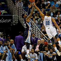 December 21, 2011; New Orleans, LA, USA; New Orleans Hornets shooting guard Eric Gordon (10) blocks a shot by Memphis Grizzlies small forward Rudy Gay (22) during the second quarter of a game at the New Orleans Arena.   Mandatory Credit: Derick E. Hingle-US PRESSWIRE