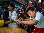 """08 FEBRUARY 2016 - BANGKOK, THAILAND: The drummer for a lion dance troupe performs in Bangkok's Chinatown district during the celebration of the Lunar New Year. Chinese New Year is also called Lunar New Year or Tet (in Vietnamese communities). This year is the """"Year of the Monkey."""" Thailand has the largest overseas Chinese population in the world; about 14 percent of Thais are of Chinese ancestry and some Chinese holidays, especially Chinese New Year, are widely celebrated in Thailand.       PHOTO BY JACK KURTZ"""
