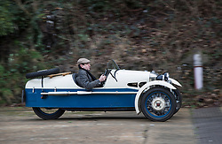 © Licensed to London News Pictures. 28/01/2018. Weybridge, UK. Competitor Andrew Messent drives a 1934 Morgan Super Sports at Brooklands Museum as he takes part in The Vintage Sports-Car Club's New Year driving tests round the historic motor racing circuit. Photo credit: Peter Macdiarmid/LNP