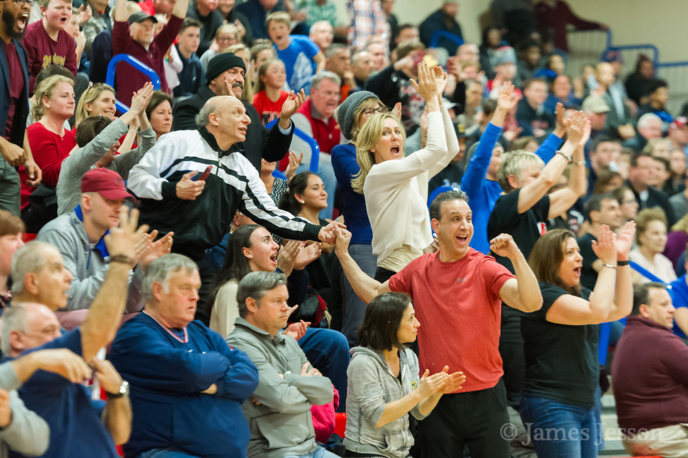 Watertown High School fans react during the MIAA Division 3 state semifinal game against Jeremiah E. Burke High School in Burlington, March 14, 2018. The Raiders won the game, 66-61. [Wicked Local Photo/James Jesson]
