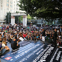 "Rapper Anthony ""King Flyz"" Cornett speaks to protesters prior to a Black Lives Matter march, Saturday, August 26, 2017, in Seattle, Washington. Several thousand people attended a downtown rally and then marched through the city to call attention to minority rights and police brutality. (Alex Menendez via AP)"