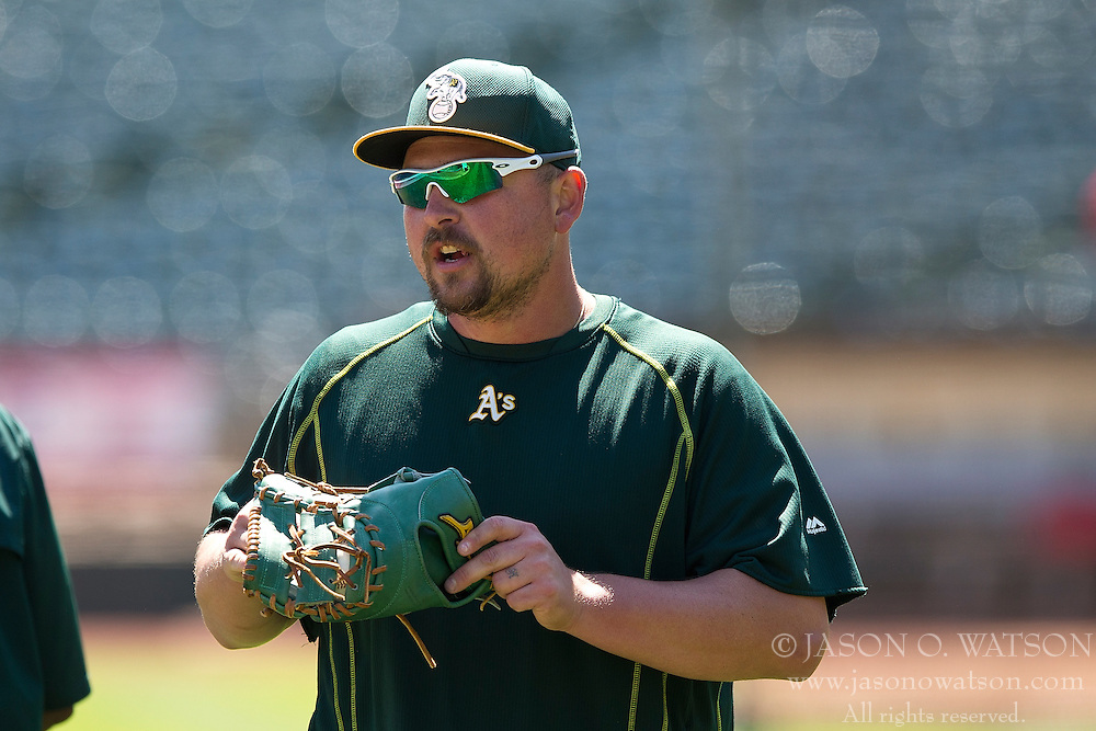 OAKLAND, CA - JUNE 21:  Billy Butler #16 of the Oakland Athletics looks on during batting practice before the game against the Los Angeles Angels of Anaheim at O.co Coliseum on June 21, 2015 in Oakland, California. The Oakland Athletics defeated the Los Angeles Angels of Anaheim 3-2. (Photo by Jason O. Watson/Getty Images) *** Local Caption *** Billy Butler