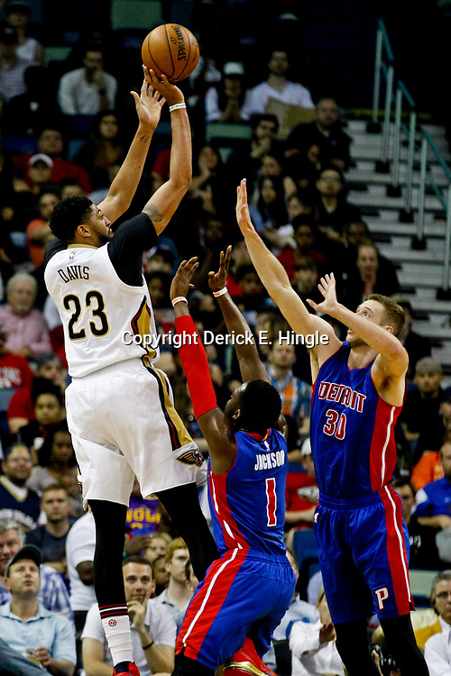 Mar 1, 2017; New Orleans, LA, USA; New Orleans Pelicans forward Anthony Davis (23) shoots over Detroit Pistons guard Reggie Jackson (1) and forward Jon Leuer (30) during the first quarter of a game at the Smoothie King Center. Mandatory Credit: Derick E. Hingle-USA TODAY Sports