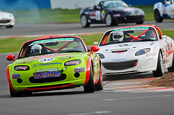 Tom Roche and Paul Sheard battle it out in the Ma5da Racing Winter Championship at Donington Park