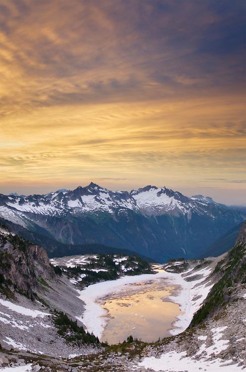 Sunrise over Forbidden and Boston Peaks from Hidden Lake Peak, North Cascades Washington
