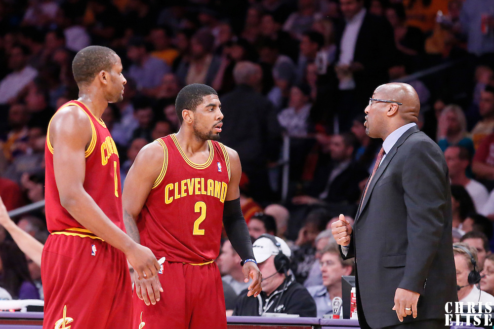 14 January 2014: Cleveland Cavaliers shooting guard C.J. Miles (0) and Cleveland Cavaliers point guard Kyrie Irving (2) listen to Cleveland Cavaliers head coach Mike Brown during the Cleveland Cavaliers 120-118 victory over the Los Angeles Lakers at the Staples Center, Los Angeles, California, USA.