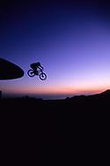 SANTA BARBARA, CA:  A man jumps his mountain bike off a water storage tower near Santa Barbara, California.