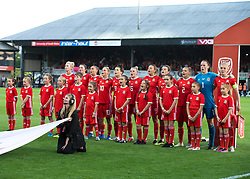 NEWPORT, WALES - Thursday, August 30, 2018: Wales line up for the anthems ahead of the FIFA Women's World Cup 2019 Qualifying Round Group 1 match between Wales and England at Rodney Parade. (Pic by Laura Malkin/Propaganda)