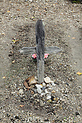 old wooden cross at a small rural graveyard