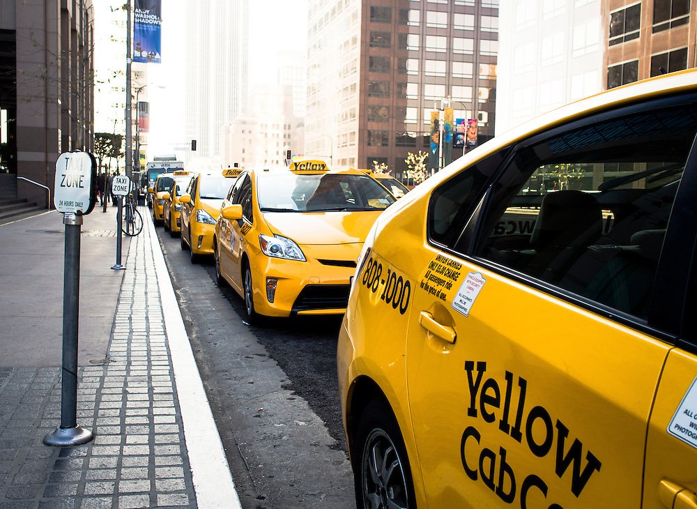 Yellow taxis line Grand Avenue in downtown Los Angeles near the Museum of Contemporary Arts (MOCA)