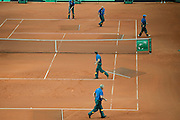 KortBud staff prepare clay court before men's double during the BNP Paribas Davis Cup 2013 between Poland and Australia at Torwar Hall in Warsaw on September 14, 2013.<br /> <br /> Poland, Warsaw, September 14, 2013<br /> <br /> Picture also available in RAW (NEF) or TIFF format on special request.<br /> <br /> For editorial use only. Any commercial or promotional use requires permission.<br /> <br /> Photo by &copy; Adam Nurkiewicz / Mediasport
