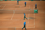 KortBud staff prepare clay court before men's double during the BNP Paribas Davis Cup 2013 between Poland and Australia at Torwar Hall in Warsaw on September 14, 2013.<br /> <br /> Poland, Warsaw, September 14, 2013<br /> <br /> Picture also available in RAW (NEF) or TIFF format on special request.<br /> <br /> For editorial use only. Any commercial or promotional use requires permission.<br /> <br /> Photo by © Adam Nurkiewicz / Mediasport
