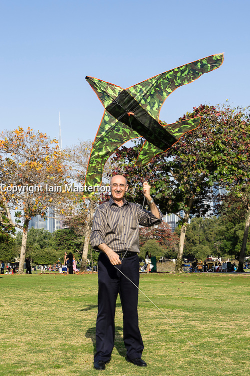 Man flying a kite in Al Safa Park in Dubai United Arab Emirates