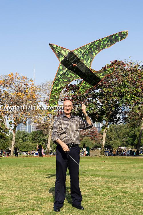 Man flying a kite in Al Safa Park in Dubai United Arab Emirates