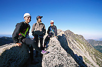 Three mountain climbers atop Prusik Peak WA&#xA;<br />