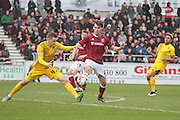 Northampton No 27 John Marquis rides a challenge in the back post in the Sky Bet League 2 match between Northampton Town and Bristol Rovers at Sixfields Stadium, Northampton, England on 9 April 2016. Photo by Nigel Cole.