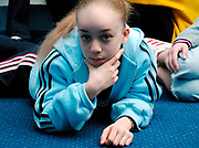 Girl lying on the floor propping up her chin with her hand