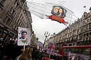 Young teenage students march against government education cuts in Regent Street. Holding a variety of placards that denounce the coalition government's policy of charging extra higher-education tuition fees, the atmosphere is excited and happy. But tens of thousands of students and school pupils walked out of class, marched, and occupied buildings around the country in the second day of mass action within a fortnight to protest at education cuts and higher tuition fees. There were isolated incidents of violence and skirmishes with police, mostly in central London among the 130,000 students.