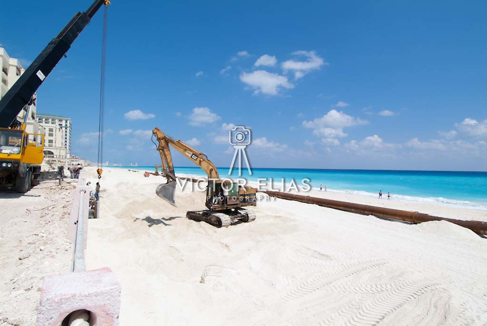 Reconstruction of the beach after hurricane Wilma. Cancun, Quintana Roo. Mexico Recontruction work on the beach of Cancun. Replenishing the sand.