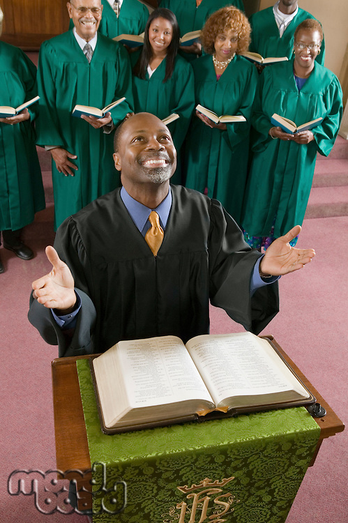 Minister Praying to God