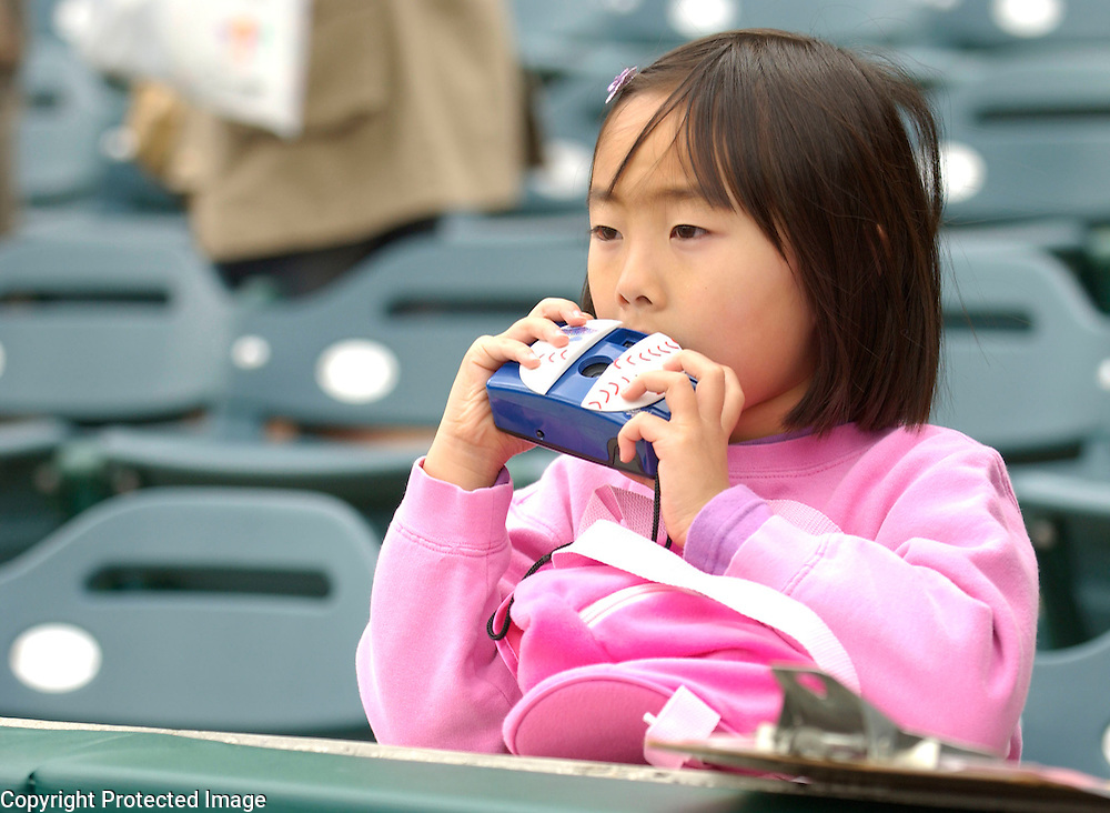 A young girl waits to take a picture of her favorite players before the start of Round 2 Japan vs USA at Angel Stadium of Anaheim.