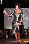 Wearing fashions from Joli, model Lynne Dorn on the runway during A'Wear Affair, the Noble Circle fundraising fashion show, at Sinclair College's David H. Ponitz Center, Saturday, February 23, 2013.  Dorn is an original member of group 1, thriving over 10 years beyond breast cancer.