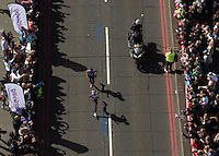 Mo Farah UK pass's Tower Bridge during  The Virgin Money London Marathon 2014. Sunday 13 April 2014<br /> <br /> Photo: Bob Martin/Virgin Money London Marathon<br /> <br /> media@london-marathon.co.ukMo Farah UK Mens Elite runner crossing Tower Bridge during  The Virgin Money London Marathon 2014. Sunday 13 April 2014<br /> <br /> Photo: Bob Martin/Virgin Money London Marathon<br /> <br /> media@london-marathon.co.uk
